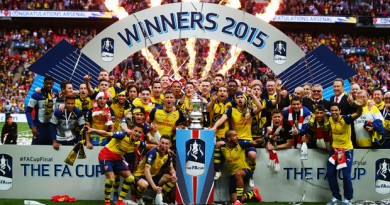 LONDON, ENGLAND - MAY 30:  Arsenal players celebrate with the trophy after the FA Cup Final between Aston Villa and Arsenal at Wembley Stadium on May 30, 2015 in London, England. Arsenal beat Aston Villa 4-0.  (Photo by Clive Rose/Getty Images)