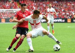 Switzerland's midfielder Granit Xhaka (R) challenges his brother Albania's midfielder Taulant Xhaka (L) during the Euro 2016 group A football match between Albania and Switzerland the Bollaert-Delelis Stadium in Lens on June 11, 2016. / AFP / FRANCOIS LO PRESTI (Photo credit should read FRANCOIS LO PRESTI/AFP/Getty Images)