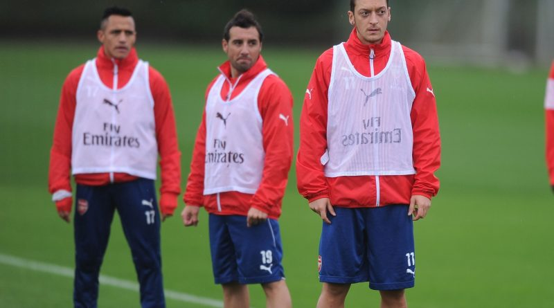 ST ALBANS, ENGLAND - OCTOBER 04: (L-R) Alexis Sanchez, Santi Cazorla and Mesut Ozil of Arsenal look on during a training session at London Colney on October 4, 2014 in St Albans, England.  (Photo by Stuart MacFarlane/Arsenal FC via Getty Images)