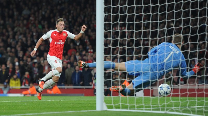LONDON, ENGLAND - OCTOBER 20:  Mesut Ozil scores Arsenal's 2nd goal past Manuel Neuer of Bayern during the UEFA Champions League match between Arsenal and Bayern Munich on October 20, 2015 in London, United Kingdom.  (Photo by David Price/Arsenal FC via Getty Images) *** Local Caption *** Mesut Ozil; Oezil; Manuel Neuer