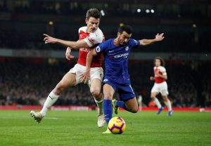 "Soccer Football - Premier League - Arsenal v Chelsea - Emirates Stadium, London, Britain - January 19, 2019 Chelsea's Pedro in action with Arsenal's Laurent Koscielny Action Images via Reuters/John Sibley EDITORIAL USE ONLY. No use with unauthorized audio, video, data, fixture lists, club/league logos or ""live"" services. Online in-match use limited to 75 images, no video emulation. No use in betting, games or single club/league/player publications. Please contact your account representative for further details."