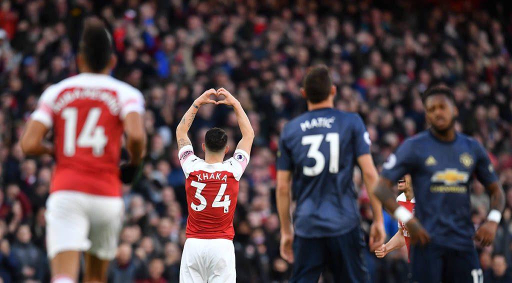 Célébration de Xhaka sur l'ouverture du score (Photo by Ben STANSALL / IKIMAGES / AFP)