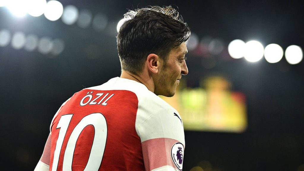 Arsenal's German midfielder Mesut Ozil reacts during the English Premier League football match between Arsenal and Newcastle United at the Emirates Stadium in London on April 1, 2019. (Photo by Glyn KIRK / AFP) / RESTRICTED TO EDITORIAL USE. No use with unauthorized audio, video, data, fixture lists, club/league logos or 'live' services. Online in-match use limited to 120 images. An additional 40 images may be used in extra time. No video emulation. Social media in-match use limited to 120 images. An additional 40 images may be used in extra time. No use in betting publications, games or single club/league/player publications. / (Photo credit should read GLYN KIRK/AFP/Getty Images)