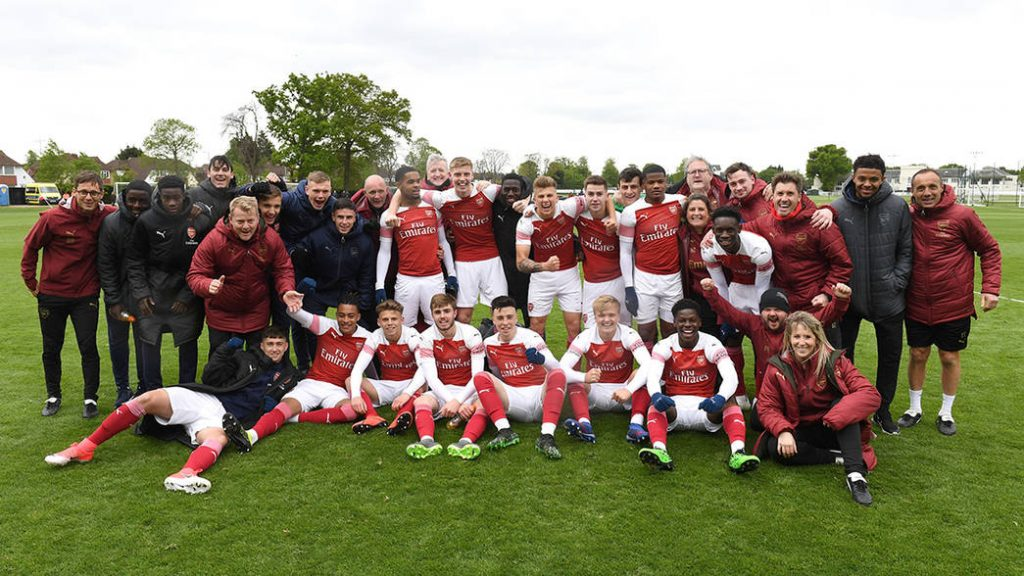 NEW MALDEN, ENGLAND - APRIL 27: Arsenal U18s players and backroom staff celebrate winning the PL U18 League after the match between Fulham and Arsenal at Fulham FC Training Ground on April 27, 2019 in New Malden, England. (Photo by David Price/Arsenal FC via Getty Images)