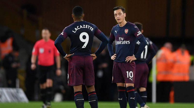WOLVERHAMPTON, ENGLAND - APRIL 24:  Mesut Ozil and Alexandre Lacazette of Arsenal look dejected during the Premier League match between Wolverhampton Wanderers and Arsenal FC at Molineux on April 24, 2019 in Wolverhampton, United Kingdom. (Photo by Laurence Griffiths/Getty Images)